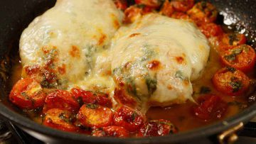 Chicken Calabrese with tomato and cheese
