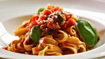 Fresh tomato and basil with freshly made fettuccine pasta