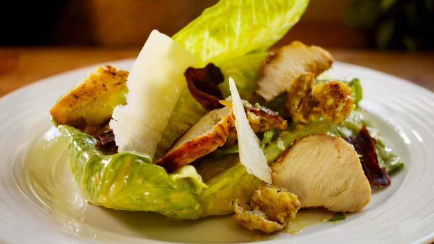 Tangy Ceasar Salad with home made dressing, grilled chicken and crispy bacon
